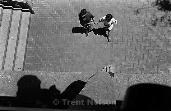 Trent feet and couple walking through plaza<br />