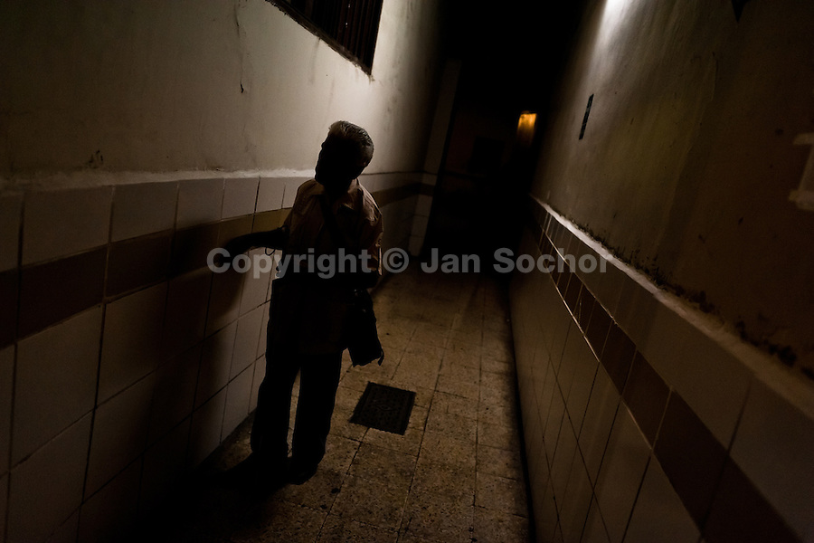 A blind man, touching the wall, finds his way in the corridor of Unión Nacional de Ciegos del Perú, a social club for the visually impaired in Lima, Peru, 4 April 2013. Unión Nacional de Ciegos del Perú, one of the first societies for disabled in Latin America, was established in 1931 to provide a daily service for blind and partially sighted people from the capital city. The range of activities includes reading books in a large Braille library, playing chess or using a computer adapted for visually impaired individuals. As the majority of the blind does not have a regular job, the UNCP club offers them an opportunity to learn and lately, to provide massages to the club visitors and thus generate some income.