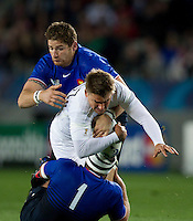 Rugby World Cup Auckland  England v France  Quarter Final 2 - 08/10/2011.Toby Flood  (England)  tackled by Jean-Baptiste Poux (France).Photo Frey Fotosports International/AMN Images