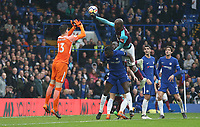 West Ham United's Angelo Ogbonna leads with his hand as he challenges Chelsea's Thibaut Courtois<br /> <br /> Photographer Rob Newell/CameraSport<br /> <br /> The Premier League - Chelsea v West Ham United - Sunday 8th April 2018 - Stamford Bridge - London<br /> <br /> World Copyright &copy; 2018 CameraSport. All rights reserved. 43 Linden Ave. Countesthorpe. Leicester. England. LE8 5PG - Tel: +44 (0) 116 277 4147 - admin@camerasport.com - www.camerasport.com