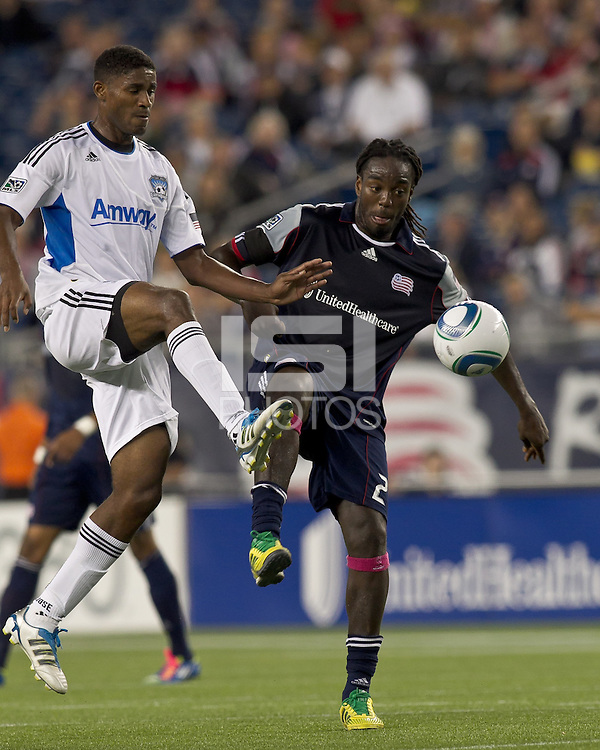New England Revolution midfielder Shalrie Joseph (21) attempts to control the ball as San Jose Earthquakes midfielder Khari Stephenson (7) pressures. In a Major League Soccer (MLS) match, the San Jose Earthquakes defeated the New England Revolution, 2-1, at Gillette Stadium on October 8, 2011.