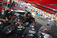 Aug. 18, 2013; Brainerd, MN, USA: Crew members warm up the engine for NHRA funny car driver Cruz Pedregon during the Lucas Oil Nationals at Brainerd International Raceway. Mandatory Credit: Mark J. Rebilas-