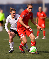 Christie Welsh of the Washington Freedom sprints away from Jennifer Buczowski of the Philadelphia Independence during their preseason game at the Maryland SoccerPlex in Germantown, Maryland.