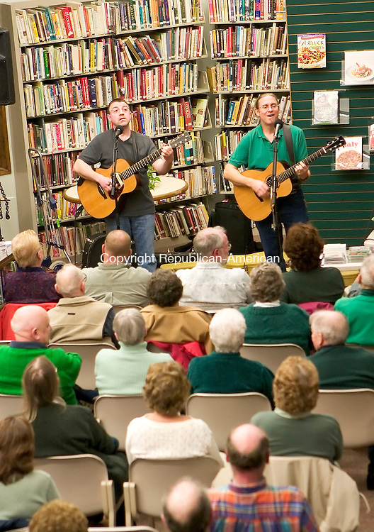 THOMASTON, CT- 14 MARCH 07- 031407JT03- <br /> Mark James and Pierce Campbell of the Kerry Boys play in front of an audience at Thomaston Public Library on Wednesday. The Connecticut Irish balladeers have been performing together for more than 15 years, with a wide collection of traditional and original songs. Campbell is Connecticut's official state troubadour for 2007-08.<br /> Josalee Thrift Republican-American