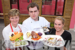 Riadas Bar Ballymacelligott Feature TASTY: Ann Marie Reidy Mangan, James Stack and.Katie Dowling presenting some of the fabulous fare available.at ORiadas Bar.