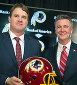 Jay Gruden, left, and Washington Redskins General Manager Bruce Allen, right, pose for a photo following a press conference at Redskins Park in Ashburn, Virginia where Gruden was introduced as the new head coach of the Washington Redskins on Thursday, January 9, 2014<br /> Credit: Ron Sachs / CNP