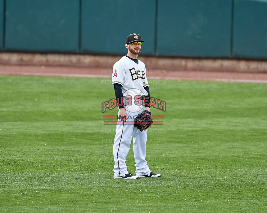Shane Robinson (9) of the Salt Lake Bees on defense against the El Paso Chihuahuas in Pacific Coast League action at Smith's Ballpark on April 30, 2017 in Salt Lake City, Utah. El Paso defeated Salt Lake 3-0. This was Game 1 of a double-header.  (Stephen Smith/Four Seam Images)