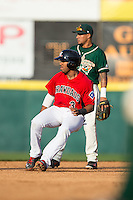 Josh Morgan (3) of the Hickory Crawdads puts on the brakes as he rounds second base during the game against the Greensboro Grasshoppers at L.P. Frans Stadium on May 6, 2015 in Hickory, North Carolina.  The Crawdads defeated the Grasshoppers 1-0.  (Brian Westerholt/Four Seam Images)