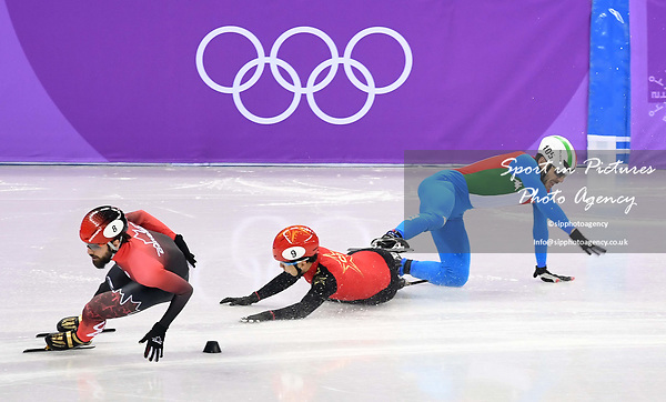 Tianyu Han (CHN) and Yuri Confortola (ITA) fall. Mens 1,500m. Short track. Gangneung ice arena. Pyeongchang2018 winter Olympics. Gangneung. Republic of Korea. 10/02/2018. ~ MANDATORY CREDIT Garry Bowden/SIPPA - NO UNAUTHORISED USE - +44 7837 394578