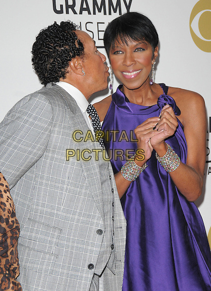 SMOKEY ROBINSON &amp; NATALIE COLE <br /> attends The GRAMMY Nominations Concert Live!! held at Nokia Theatre L.A. Live in Los Angeles, California on December 3rd 2008.<br /> half length black coat patent bag dangly earrings purple funny grey gray suit hands top silk satin<br /> CAP/DVS<br /> &copy;Debbie VanStory/Capital Pictures