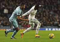 Picture: Andrew Roe/AHPIX LTD, Football, Barclays Premier League, Manchester City v Swansea City, 22/11/14, Etihad Stadium, K.O 3pm<br /> <br /> Swansea's Madou Barrow gets away from City's Gael Clichy<br /> <br /> Andrew Roe>>>>>>>07826527594