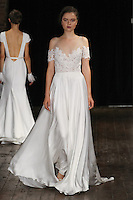 """Model walks runway in a """"Lust"""" bridal gown from the Rivini by Rita Vinieris Fall 2017 collection on October 7th, 2016 during New York Bridal Fashion Week."""