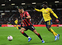 27th January 2020; Vitality Stadium, Bournemouth, Dorset, England; English FA Cup Football, Bournemouth Athletic versus Arsenal; Dominic Solanke of Bournemouth turns on the ball under pressure from Bukayo Saka of Arsenal