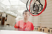 "August 25, 2010. Durham, North Carolina..  Artist Tim Lee looks at the installation of his work, titled "" Public Enemy, Fear of a Black Planet, 1990, 2006."". The installation of ""The Record, Contemporary Art and Vinyl"" the new exhibit at the Nasher Museum of Art that explores the culture of vinyl records through 50 years of contemporary art."