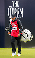210719 | The 148th Open - Final Round<br /> <br /> Rortrush man Ricky Elliott with the bag of Brooks Koepka of USA and his caddie on the 1st during the final round of the 148th Open Championship at Royal Portrush Golf Club, County Antrim, Northern Ireland. Photo by John Dickson - DICKSONDIGITAL