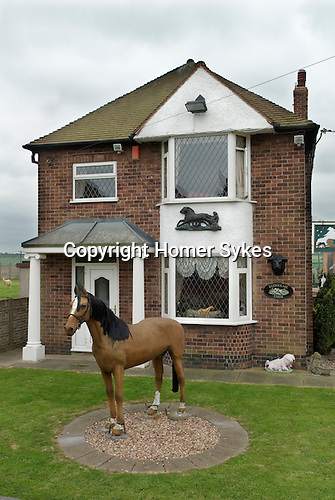 House decoration with fibre glass horse in front garden Leicestershire UK