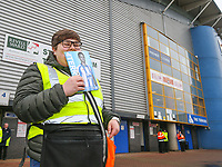 A programme seller poses for a picture<br /> <br /> Photographer Alex Dodd/CameraSport<br /> <br /> The Premier League - Huddersfield Town v Swansea City - Saturday 10th March 2018 - John Smith's Stadium - Huddersfield<br /> <br /> World Copyright &copy; 2018 CameraSport. All rights reserved. 43 Linden Ave. Countesthorpe. Leicester. England. LE8 5PG - Tel: +44 (0) 116 277 4147 - admin@camerasport.com - www.camerasport.com