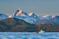 Fishing vessel New Venture in Sitka Sound with Mount Annahootz on Baranof Island in the distance.