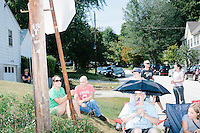 People watch the Labor Day parade in Milford, New Hampshire. Republican presidential candidates John Kasich, Carly Fiorina, and Lindsey Graham, and Democratic presidential candidate Bernie Sanders marched in the parade.