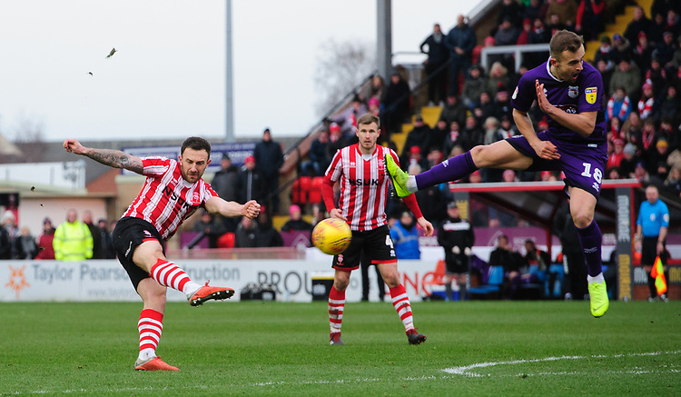 Lincoln City's Neal Eardley under pressure from Grimsby Town's Charles Vernam<br /> <br /> Photographer Chris Vaughan/CameraSport<br /> <br /> The EFL Sky Bet League Two - Lincoln City v Grimsby Town - Saturday 19 January 2019 - Sincil Bank - Lincoln<br /> <br /> World Copyright &copy; 2019 CameraSport. All rights reserved. 43 Linden Ave. Countesthorpe. Leicester. England. LE8 5PG - Tel: +44 (0) 116 277 4147 - admin@camerasport.com - www.camerasport.com