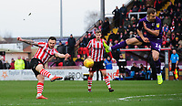 Lincoln City's Neal Eardley under pressure from Grimsby Town's Charles Vernam<br /> <br /> Photographer Chris Vaughan/CameraSport<br /> <br /> The EFL Sky Bet League Two - Lincoln City v Grimsby Town - Saturday 19 January 2019 - Sincil Bank - Lincoln<br /> <br /> World Copyright © 2019 CameraSport. All rights reserved. 43 Linden Ave. Countesthorpe. Leicester. England. LE8 5PG - Tel: +44 (0) 116 277 4147 - admin@camerasport.com - www.camerasport.com