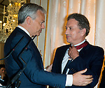 "Michel Drucker and Deputy Prime Minister Didier Reynders  at the ceremony who Michel Drucker was awarded at  the title of Commander of the Order of the Crowne at the Palace Egmont"" at Brussels, 2014 in Brussels, Belgium."