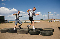 mr-cadets0530   159009- Arizona Project Challenge cadets Cutter Johnson, left, (CQ) and  Michael Jensen run through an obstacle course during PT.   The program provides a live-in military based education for high school drop outs.  Michael Jensen, of Gilbert, will be the first Arizona Project Challenge cadet to graduate with a high school diploma from Sequoia Choice Arizona Distance Learning in Mesa. (Pat Shannahan/ The Arizona Republic)