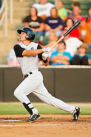 Joe De Pinto #5 of the Kannapolis Intimidators follows through on his swing against the Greensboro Grasshoppers at CMC-Northeast Stadium on July 4, 2012 in Kannapolis, North Carolina.  The Intimidators defeated the Grasshoppers 6-1.  (Brian Westerholt/Four Seam Images)