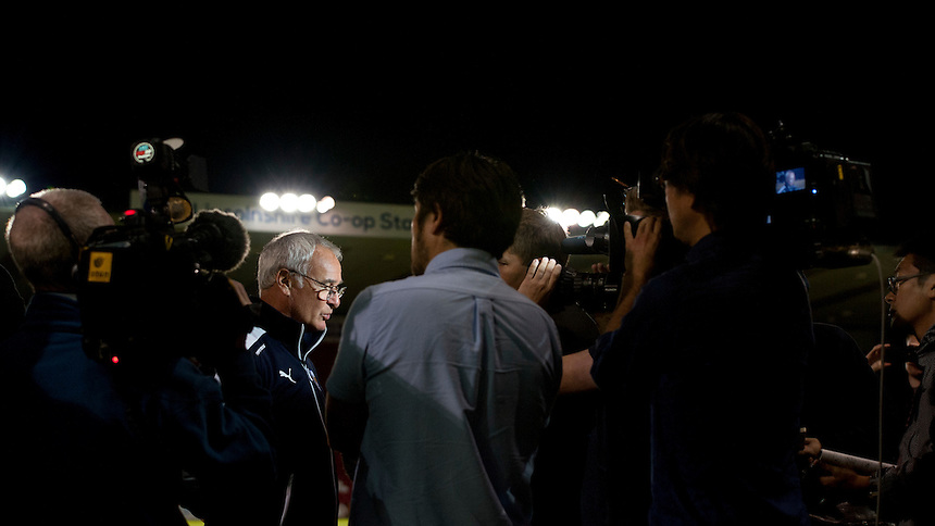 Leicester City Manager Claudio Ranieri speaks to the media at the end of his first game in charge of the club<br /> <br /> Photographer Chris Vaughan/CameraSport<br /> <br /> Football - Football Friendly - Lincoln City v Leicester City - Tuesday 21st July 2015 - Sincil Bank - Lincoln<br /> <br /> &copy; CameraSport - 43 Linden Ave. Countesthorpe. Leicester. England. LE8 5PG - Tel: +44 (0) 116 277 4147 - admin@camerasport.com - www.camerasport.com