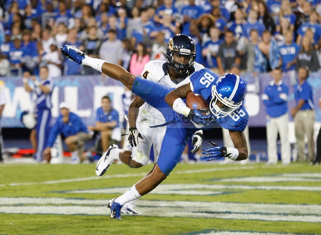 Senior wide receiver Gene McCaskill catches the ball for a touchdown against Kent State at Commonwealth Stadium on Saturday, Sept. 8, 2012. Photo by Scott Hannigan | Staff