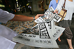 General view, SEPTEMBER 8, 2013 : A vendor hands out free copies of a newspaper special edition printed to mark the announcement of Tokyo as the host of the 2020 Olympic Games, in Tokyo, Sunday morning, Sept. 8, 2013. The headline reads: 2020 Tokyo Olympics, 56 years since the 1964 Tokyo Olympics. (Photo by Yusuke Nakanishi/AFLO SPORT) [1090]
