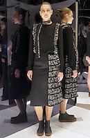 Model in Look 21: Floral Peplum Top, Floral Peplum Skirt