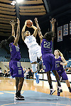 21 December 2013: North Carolina's Allisha Gray (15) shoots over High Point's Latrice Phelps (22). The University of North Carolina Tar Heels played the High Point University Panthers in an NCAA Division I women's basketball game at Carmichael Arena in Chapel Hill, North Carolina. UNC won the game 103-71.