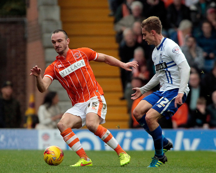 Blackpool's Tom Aldred tries to get away from Bury's Chris Sedgwick<br /> <br /> Photographer David Shipman/CameraSport<br /> <br /> Football - The Football League Sky Bet League One - Bury v Blackpool - Saturday 31st October 2015 - Gigg Lane - Bury <br /> <br /> &copy; CameraSport - 43 Linden Ave. Countesthorpe. Leicester. England. LE8 5PG - Tel: +44 (0) 116 277 4147 - admin@camerasport.com - www.camerasport.com