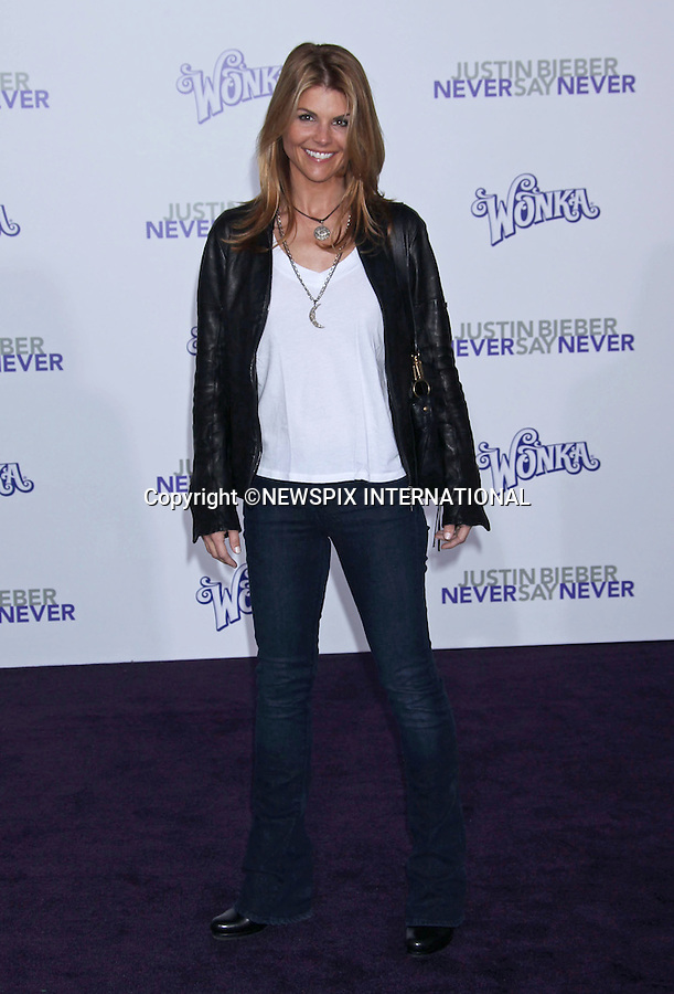 """LORI LAUGHLIN.at Justin Bieber's """"Never Say Never"""" World Premiere, Nokia Theatre, Los Angeles_08/02/2011.Mandatory Photo Credit: ©M.Philips_Newspix International..**ALL FEES PAYABLE TO: """"NEWSPIX INTERNATIONAL""""**..PHOTO CREDIT MANDATORY!!: NEWSPIX INTERNATIONAL(Failure to credit will incur a surcharge of 100% of reproduction fees)..IMMEDIATE CONFIRMATION OF USAGE REQUIRED:.Newspix International, 31 Chinnery Hill, Bishop's Stortford, ENGLAND CM23 3PS.Tel:+441279 324672  ; Fax: +441279656877.Mobile:  0777568 1153.e-mail: info@newspixinternational.co.uk"""