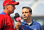 21 June 2011: Washington Nationals Manager Jim Riggleman is interviewed by radio broadcaster Charlie Slowes prior to a game against the Seattle Mariners at Nationals Park in Washington, District of Columbia. The Nationals rallied from a 5-1 deficit, scoring 5 runs in the bottom of the 9th, to defeat the Mariners 6-5 in inter-league play. Mandatory Credit: Ed Wolfstein Photo