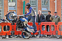 21/02/'11 Spectators look on as  World Champion Street Bike Freestyle Rider, Mattie Griffin pictured this afternoon at Smithfield Square where he demonstrated some of his skills and stunts at the launch of the 'ZUP', the world's first motorcycle clothing connector system. ZUP allows riders to turn their favourite riding gear, leather into a suit by connecting trousers with jacket at the waist. The system was developed by two Irish bikers, Doreen Connaughton and Frank Mullen..Picture Colin Keegan, Collins, Dublin.