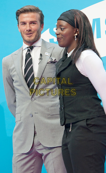 David Beckham & Gabriella Roseje.Samsung kicks-off its London 2012 campaign 'Everyone's Olympic Games', Canary Wharf, London, England..13th June 2011.half length grey gray suit jacket stubble trousers beard facial hair blazer black white tie  waistcoat black profile headband.CAP/ROS.©Steve Ross/Capital Pictures.