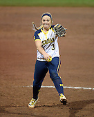 Michigan Wolverines Softball pitcher Megan Betsa (3) delivers a pitch during a game against the University of South Florida Bulls on February 8, 2014 at the USF Softball Stadium in Tampa, Florida.  Michigan defeated USF 3-2.  (Copyright Mike Janes Photography)
