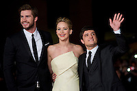 (L-R) Liam Hemsworth and Jennifer Lawrence with Josh Hutcherson attends 'The Hunger Games: Catching Fire' Premiere during The 8th Rome Film Festival. Liam Hemsworth, Jennifer Lawrence e Josh Hutcherson posano al red carpet del Festival del cinema di Roma per la prima del film The Hunger Games: Catching Fire.