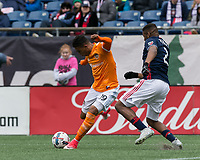 Foxborough, Massachusetts - April 8, 2017: First half action. In a Major League Soccer (MLS) match, New England Revolution (blue/white) vs Houston Dynamo (orange/white), at Gillette Stadium.