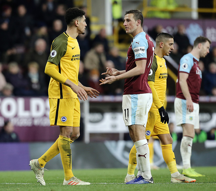 Burnley's Chris Wood exchanges words with Brighton & Hove Albion's Leon Balogun after his high kick injured Phillip Bardsley in the penalty area<br /> <br /> Photographer Rich Linley/CameraSport<br /> <br /> The Premier League - Burnley v Brighton and Hove Albion - Saturday 8th December 2018 - Turf Moor - Burnley<br /> <br /> World Copyright © 2018 CameraSport. All rights reserved. 43 Linden Ave. Countesthorpe. Leicester. England. LE8 5PG - Tel: +44 (0) 116 277 4147 - admin@camerasport.com - www.camerasport.com