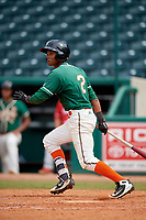 Greensboro Grasshoppers second baseman Jose Devers (2) follows through on a swing during a game against the Lakewood BlueClaws on June 10, 2018 at First National Bank Field in Greensboro, North Carolina.  Lakewood defeated Greensboro 2-0.  (Mike Janes/Four Seam Images)