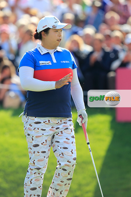 Shanshan Feng (CHN) sinks her putt on the 18th green during Sunday's Final Round of the LPGA 2015 Evian Championship, held at the Evian Resort Golf Club, Evian les Bains, France. 13th September 2015.<br /> Picture Eoin Clarke | Golffile