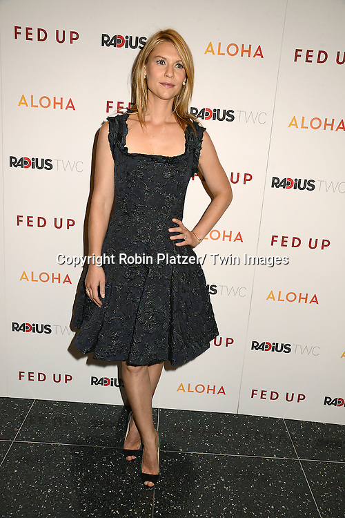 """Claire Danes in Lanvin black dress attends the New York Premiere of """"FED UP"""" on May 6, 2014 at The Museum of Modern Art in New York City."""