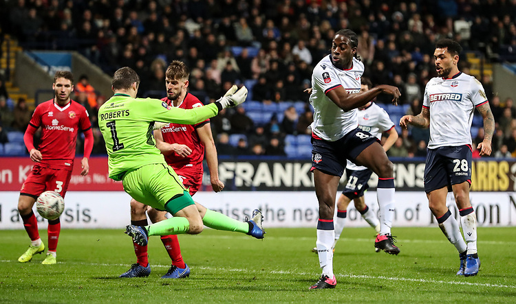 Bolton Wanderers' Clayton Donaldson scoring his side's third goal against Walsall's goalkeeper Liam Roberts <br /> <br /> Photographer Andrew Kearns/CameraSport<br /> <br /> Emirates FA Cup Third Round - Bolton Wanderers v Walsall - Saturday 5th January 2019 - University of Bolton Stadium - Bolton<br />  <br /> World Copyright © 2019 CameraSport. All rights reserved. 43 Linden Ave. Countesthorpe. Leicester. England. LE8 5PG - Tel: +44 (0) 116 277 4147 - admin@camerasport.com - www.camerasport.com