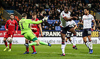 Bolton Wanderers' Clayton Donaldson scoring his side's third goal against Walsall's goalkeeper Liam Roberts <br /> <br /> Photographer Andrew Kearns/CameraSport<br /> <br /> Emirates FA Cup Third Round - Bolton Wanderers v Walsall - Saturday 5th January 2019 - University of Bolton Stadium - Bolton<br />  <br /> World Copyright &copy; 2019 CameraSport. All rights reserved. 43 Linden Ave. Countesthorpe. Leicester. England. LE8 5PG - Tel: +44 (0) 116 277 4147 - admin@camerasport.com - www.camerasport.com