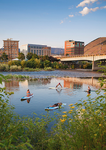 stand up paddle boards used in a yoga class held on the clark fork river in downtown missoula, montana on a summer evening