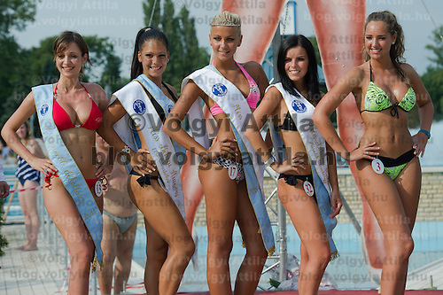 Special award winners Adrienn Lukacs (L) for best decolletage, Angela Toth (2nd L) for best bottom, Szilvia Kalman (C) for best back and Evelin Szalai (2nd R) for best face and finalist Zsuzsanna Farkas (R) pose during the Miss Bikini Hungary beauty contest held in Budapest, Hungary on August 06, 2011. ATTILA VOLGYI