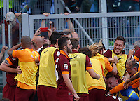 Calcio, Serie A: Lazio vs Roma. Roma, stadio Olimpico, 25 maggio 2015.<br /> Roma's Juan Iturbe i hidden by teammates hugs after scoring during the Italian Serie A football match between Lazio and Roma at Rome's Olympic stadium, 25 May 2015.<br /> UPDATE IMAGES PRESS/Riccardo De Luca